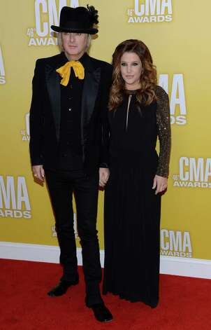 Lisa Marie Presley (R) and Michael Lockwood attend the 46th annual CMA Awards at the Bridgestone Arena on November 1, 2012 in Nashville, Tennessee. Photo: Jason Kempin, Getty Images / 2012 Getty Images
