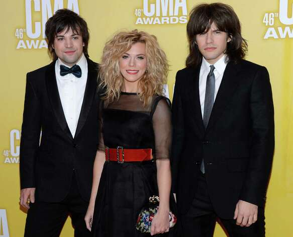 (L-R) Neil Perry, Kimberly Perry, and Reid Perry of The Band Perry attend the 46th annual CMA Awards at the Bridgestone Arena on November 1, 2012 in Nashville, Tennessee. Photo: Jason Kempin, Getty Images / 2012 Getty Images