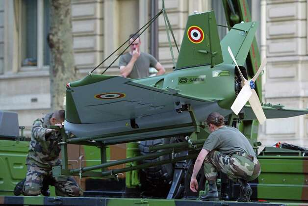 French soldiers set up a drone on a vehicle on July 14, 2004, prior the Bastille Day parade down the Champs Elysees in Paris. Photo: MEHDI FEDOUACH, AFP/Getty Images / 2004 AFP