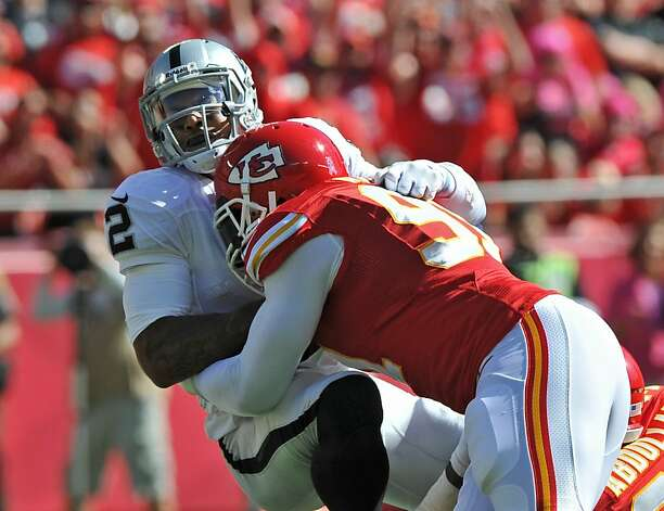 Tamba Hali, who had 3 1/2 sacks, brings down Terrelle Pryor in the first half. Photo: Peter Aiken, Getty Images