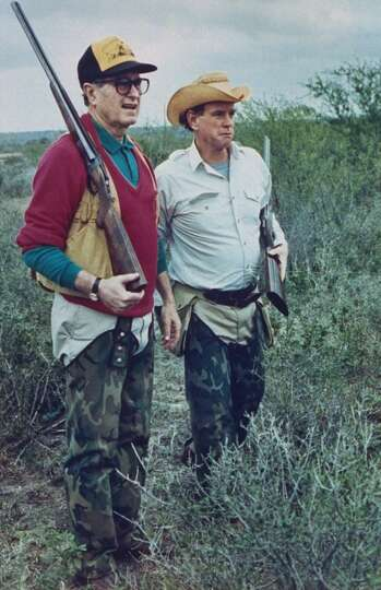 US Pres. George Bush dressed in hunting gear w. friend/oil heir William Farish, both sporting shotgu