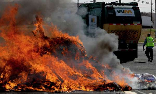 Garbage truck's load erupts in flames - San Antonio ...