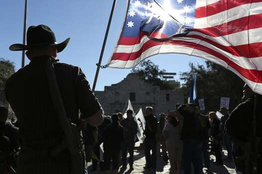 "John Moltzer, of Robinson, waits for the ""Come and Take It"" rally to begin at the Alamo on Saturday, Oct. 19, 2013. Photo: SAN ANTONIO EXPRESS-NEWS"