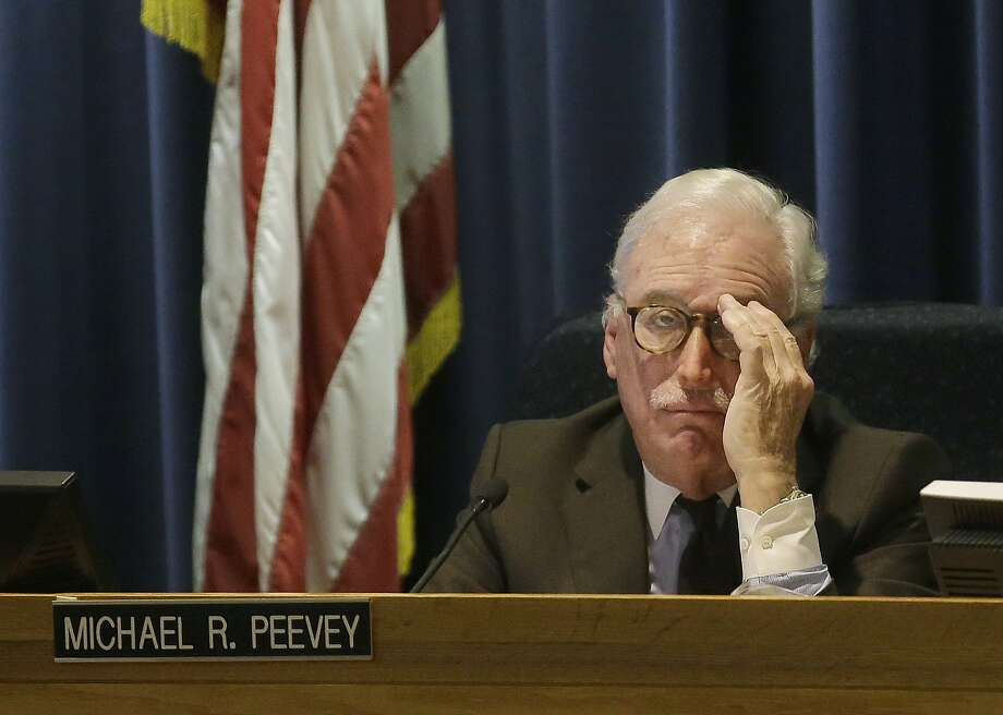 Michael Peevey, former California Public Utilities Commission president, at his last commission meeting in San Francisco in December. Photo: Jeff Chiu / Jeff Chiu / Associated Press / AP