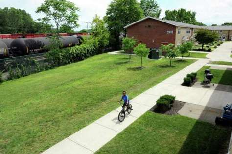 View of the courtyard between the apartment buildings and the rail line that carries oil tankers to the Port of Albany  Wednesday, July 16, 2014, at Ezra Prentice Homes in Albany, N.Y. (Cindy Schultz / Times Union) Photo: Cindy Schultz / 00027815A