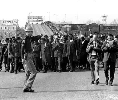 Martin Luther King, Jr., and his demonstrators stream over an Alabama River bridge at the city limits of Selma, Ala., March 10, 1965, during a voter rights march.  They were stopped and turned back a short time later.  A federal judge had banned the march. Photo: AP / 1965 AP