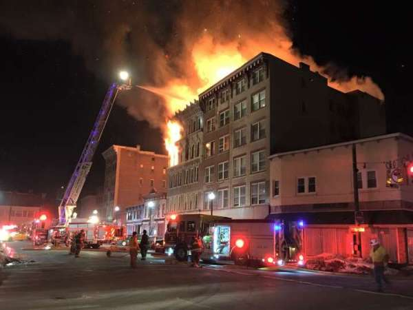 Firefighters battle a raging fire at 104 Jay St ...