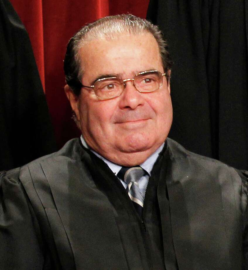 Justice Antonin Scalia poses for a group portrait of the Supreme Court in this file photo. Photo: Pablo Martinez Monsivais, STF / 2010 AP