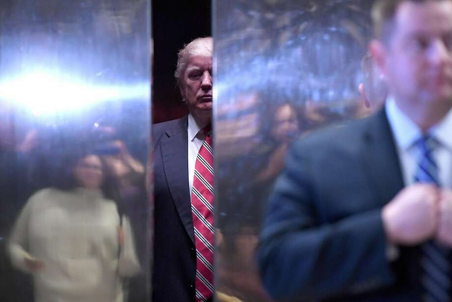 President-elect Donald Trump, seen in an elevator in the lobby of Trump Tower in New York, Photo: Anthony Behar, Bloomberg