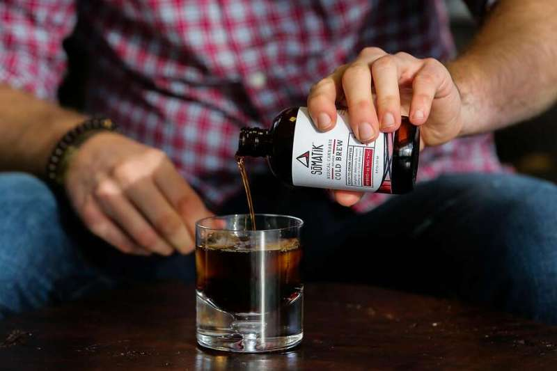 Somatik CEO Chris Schroeder pours his cold brewed coffee infused with THC into a glass at his office in Oakland, Calif., on Tuesday, Jan. 17, 2017. Somatik is partnering with Ritual coffee to release an 8-oz bottle of cold brewed coffee with 15 mg of THC in it which is slated to hit the market next week. Photo: Gabrielle Lurie, The Chronicle
