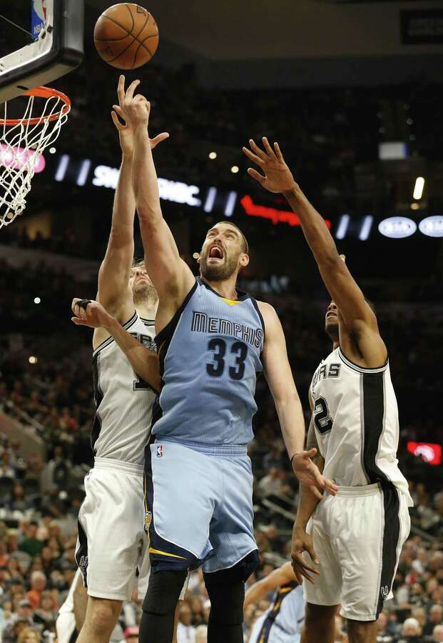 Spurs' Pau Gasol (16) and Kawhi Leonard (02) attempt to defend against Memphis Grizzlies' Marc Gasol (33) during their game at the AT&T Center on Tuesday, Apr. 4, 2017. Spurs defeated the Grizzlies in overtime, 95-89. (Kin Man Hui/San Antonio Express-News) Photo: Kin Man Hui, Staff / San Antonio Express-News / ©2017 San Antonio Express-News