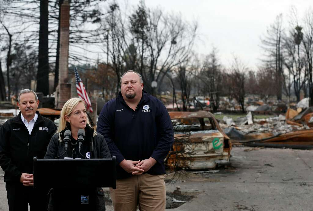 Department of Homeland Security Secretary Kirstjen Nielsen speaks at a news conference Wednesday in Santa Rosa after touring areas destroyed in the Tubbs Fire with Mark Ghilarducci (left), director of the California Office of Emergency Services, and FEMA Regional Director Bob Fenton. Photo: Paul Chinn, The Chronicle