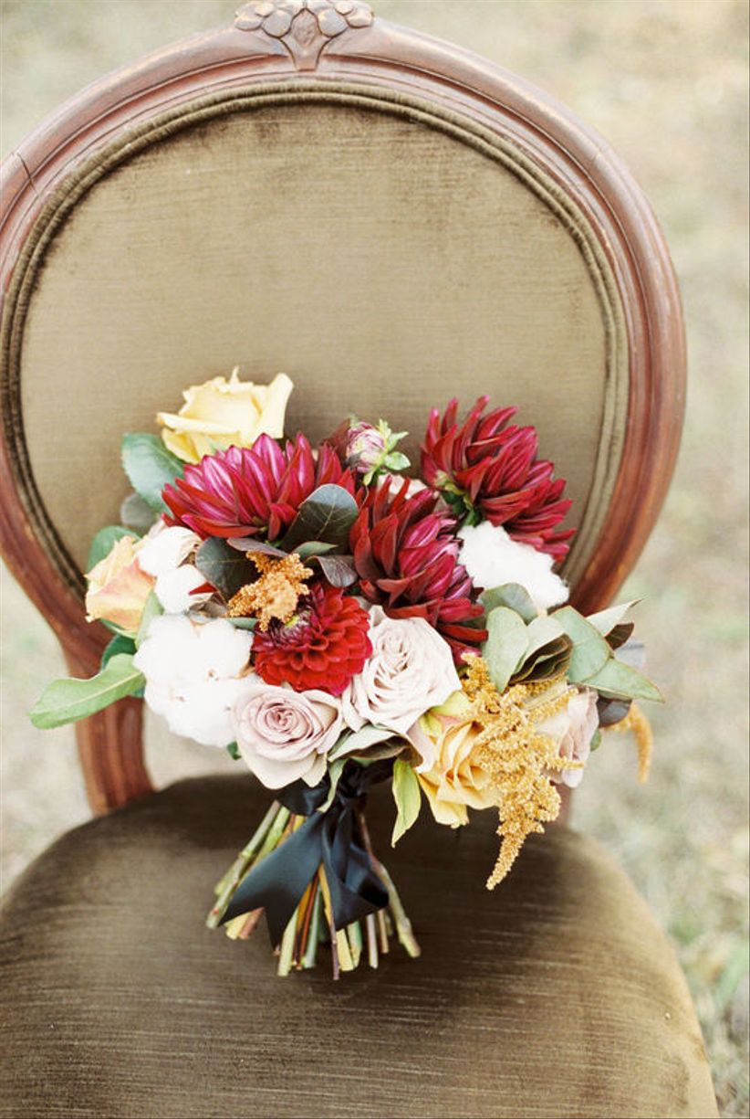 fall wedding bouquet with burgundy dahlias and pink roses