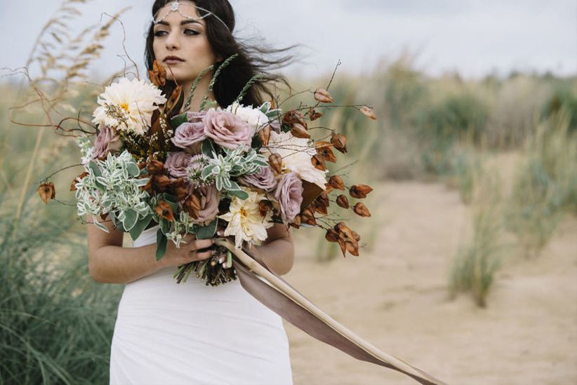oversized fall wedding bouquet with foraged leaves and long ribbons