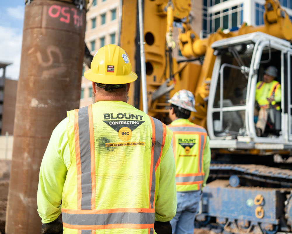 Blount Crew working together on 100 Mill Office Tower