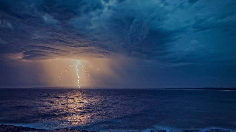 Lightning at sea for a post by Winnie Winkle Writing books has flow and meaning.
