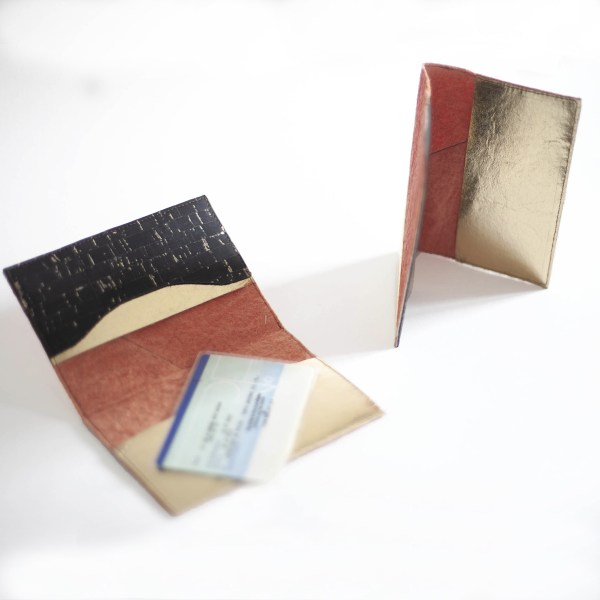 Delia Passport cover in Piñatex Cork Paprika Gold in situation