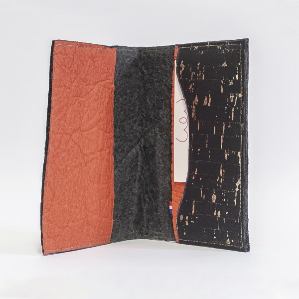 Interior view of the Delia passport cover made of Paprika and Black Piñatex® and cork