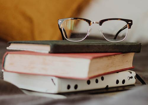 eye glasses on a stack of books