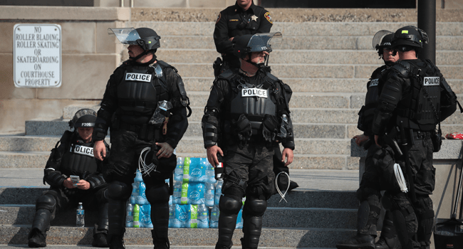 Police gather in front of the Kenosha County Court House after a night of unrest, on August 24, 2020 in Kenosha, Wisconsin. Scott Olson/Getty Images/AFP