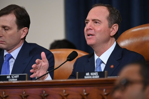 House Intelligence Committee Chairman Adam Schiff, D-Calif., asks former National Security Council official Fiona Hill and State department official David Holmes questions as they testify in a public hearing in the impeachment inquiry into allegations President Donald Trump pressured Ukraine to investigate his political rivals on Capitol Hill in Washington, Nov. 21, 2019.