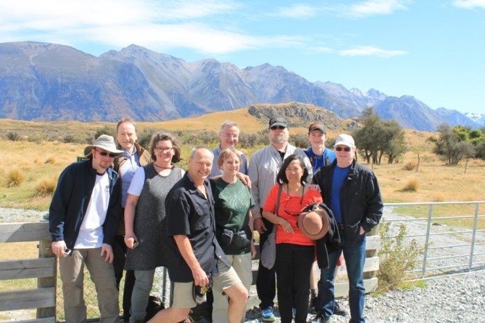 Bruce and his 9 clients standing in front of Edoras
