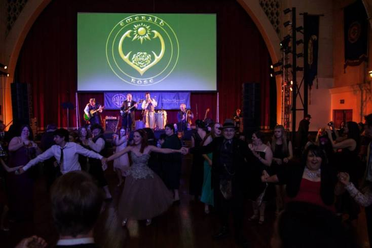 Party-goers dancing to Emerald Rose