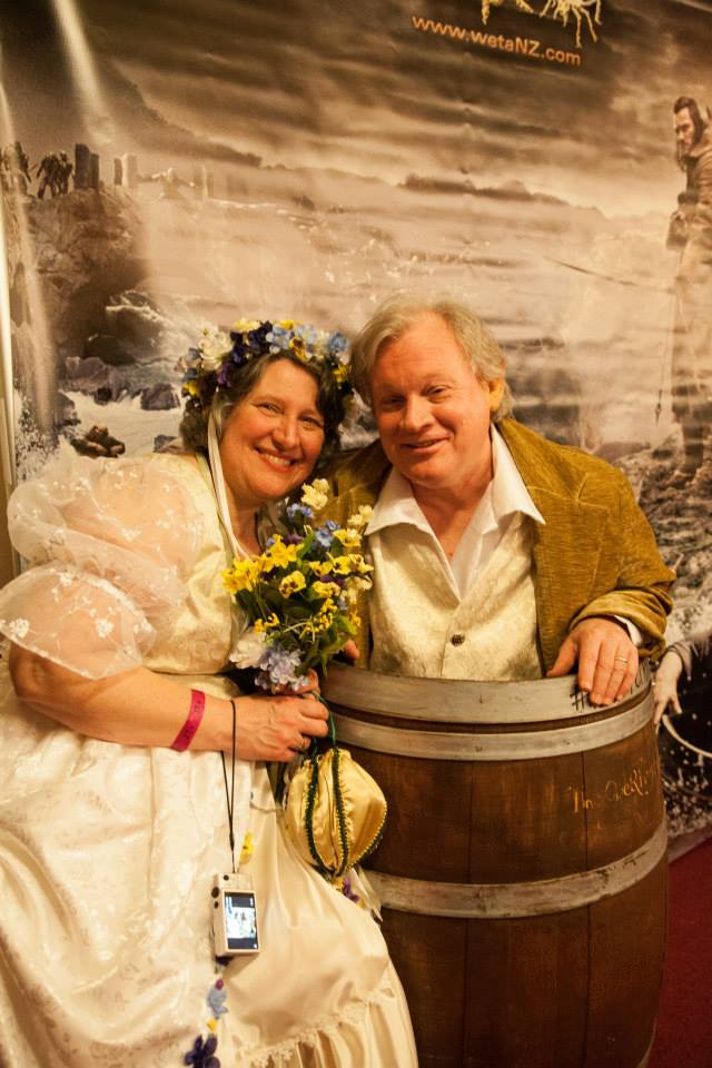 Party goers dressed as Rosie and Sam on their wedding day