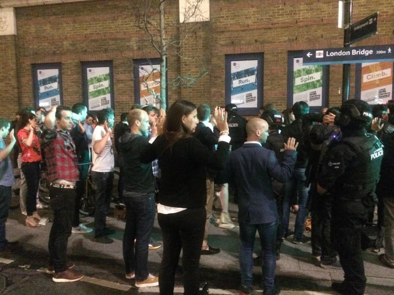 Armed cops check people at London Bridge
