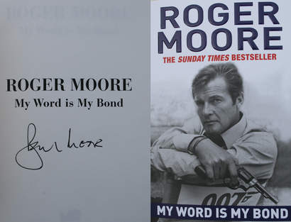 "Roger Moore and Bond change books. Roger Moores   ""My word is my Bond""  JAMES BOND 007 MUSEET"