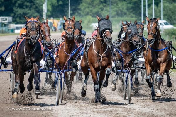 Pikeur Frans van der Blonk en Durk M Boko sleuren met nog een ronde te gaan aan kop van het peloton in de 64ste editie van de Gouden Zweep
