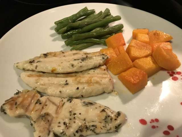 Grilled chicken tenders paired with roasted butternut squash and green beans