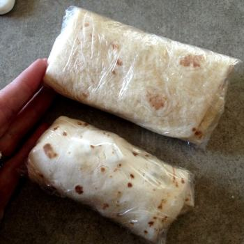 Wrap breakfast burritos with plastic wrap