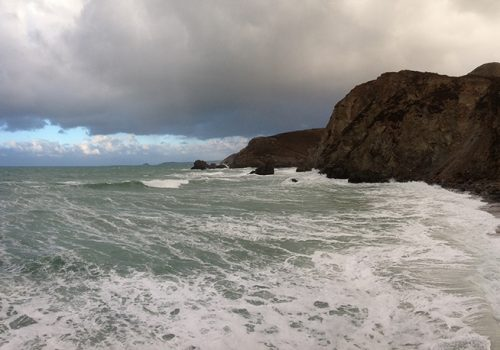 Stormy seas and ominous rain clouds over Trevaunance Cove, St Agnes, Cornwall. Copyright Stephanie Boon, 2018, All Rights Reserved