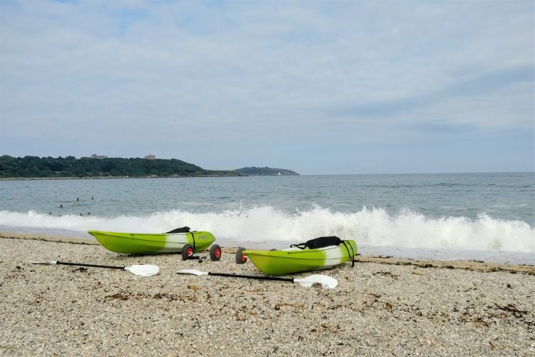 2 green kyaks on Gyllingvase Beach, Falmouth, Cornwall, UK. The start of Falmouth Big Circular Walk. Copyright Stephanie Boon, 2018. All rights reserved.