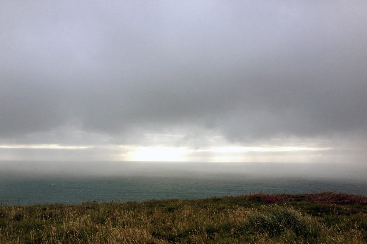 Bank of rain coming in, The Strangles near Crackington Haven. South West Coast Path, North Cornwall. Copyright Stephanie Boon, 2017. All Rights Reserved