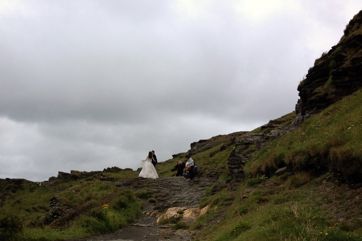 Bride and Groom on the cliffs of Boscastle Harbour, South West Coast Path, North Cornwall. Copyright Stephanie Boon, 2018. All rights Reserved.