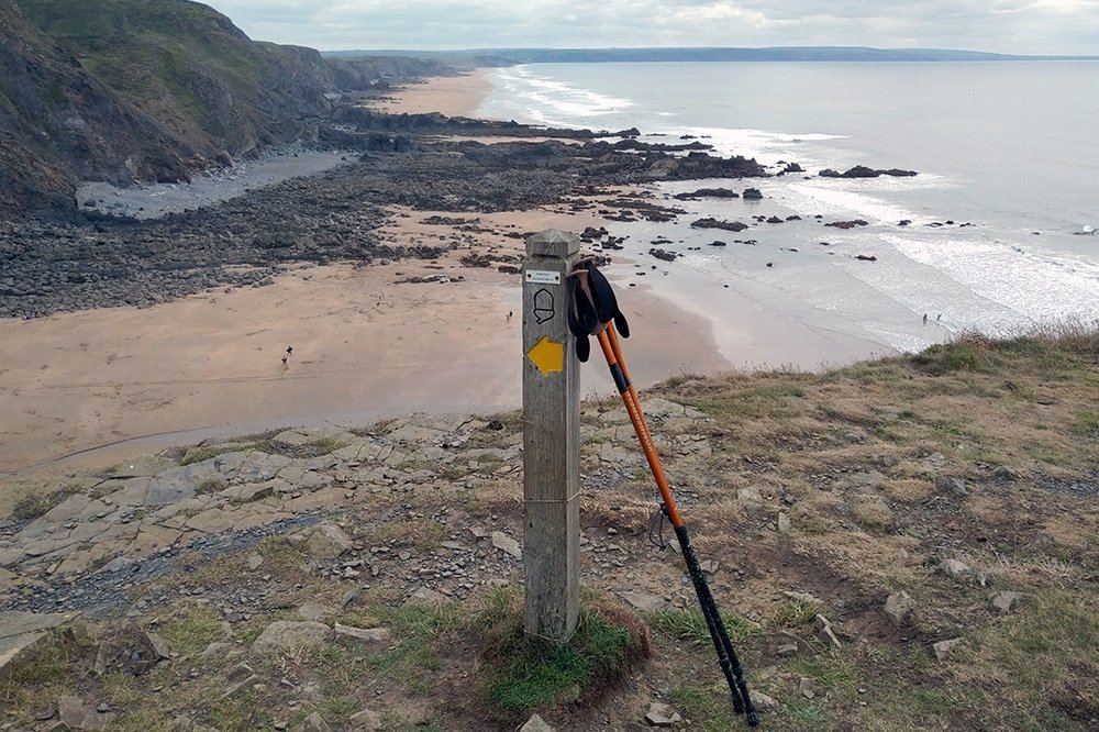 South West Coast Path national trail post on the cliffs above Duckpool, Cornwall, UK. Copyright Stephanie Boon, 2018. All Rights Reserved.