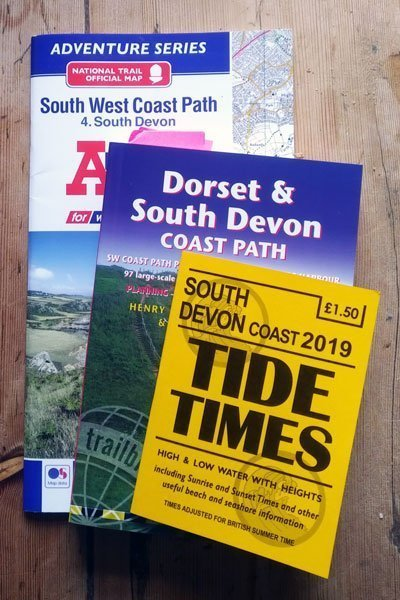 A-Z advendure map, Trailblazer South Devon Guide and a South Devon tide table.