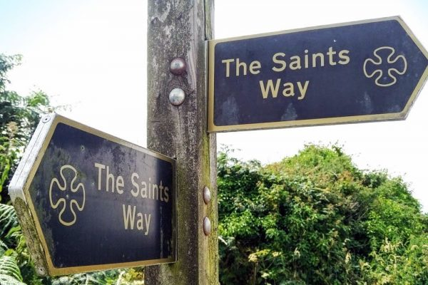 The distinctive black and gold signposts on The Saints' Way