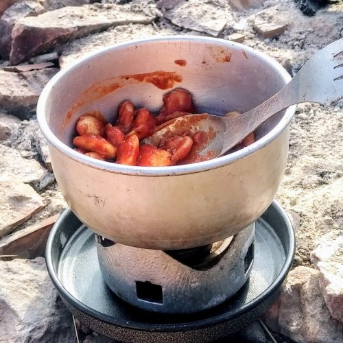Cooking up beans and tomato sauce on the cliff tops (close up of beans and cooking stove)