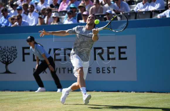 France's Adrian Mannarino in action against Novak Djokovic of Serbia during their quarter final match at the Fever Tree Championship at Queen's Club in London, Britain, 22 June 2018. EPA-EFE/NEIL HALL