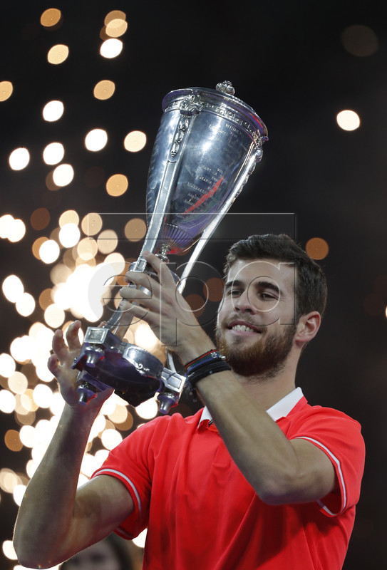 Karen Khachanov of Russia poses with the trophy after winning the men's final of the Kremlin Cup tennis tournament in Moscow, Russia, 21 October 2018.  EPA-EFE/SERGEI ILNITSKY