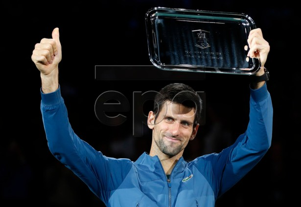 Novak Djokovic of Serbia poses with the second place trophy after losing the final match against Karen Khachanov of Russia at the Rolex Paris Masters tennis tournament in Paris, France, 04 November 2018.  EPA-EFE/IAN LANGSDON