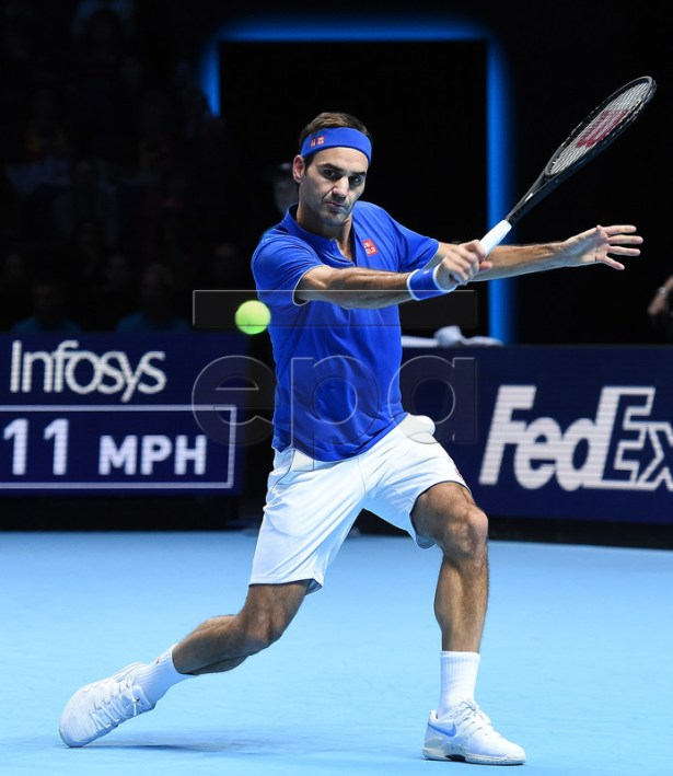 Switzerland's Roger Federer returns to Austria's Dominic Thiem during an ATP Tour Finals tennis match at the O2 Arena in London, Britain, 13 November 2018.  EPA-EFE/ANDY RAIN