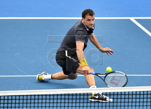 Grigor Dimitrov of Bulgaria in action against Yoshihito Nishioka of Japan during day one of the Brisbane International tennis tournament  at the Queensland Tennis Centre in Brisbane, Australia, 31 December 2018.  EPA-EFE/DARREN ENGLAND EDITORIAL USE ONLY AUSTRALIA AND NEW ZEALAND OUT