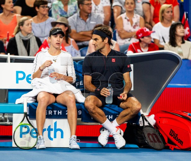 Belinda Bencic (L) and Roger Federer of Switzerland during the mixed doubles match between Switzerland and Germany on day 8 of the Hopman Cup tennis tournament at RAC Arena in Perth, Australia, 05 January 2019.  EPA-EFE/TONY MCDONOUGH AUSTRALIA AND NEW ZEALAND OUT  EDITORIAL USE ONLY