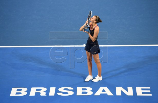 Karolina Pliskova of the Czech Republic kisses her trophy after winning the women's singles final match against Lesia Tsurenko of Ukraine at the Brisbane International tennis tournament in Brisbane, Australia, 06 January 2019. EPA-EFE/DAN PELED EDITORIAL USE ONLY AUSTRALIA AND NEW ZEALAND OUT