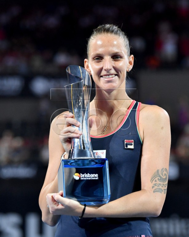 Karolina Pliskova of the Czech Republic holds her trophy after winning the women's singles final match against Lesia Tsurenko of Ukraine at the Brisbane International tennis tournament in Brisbane, Australia, 06 January 2019. EPA-EFE/DARREN ENGLAND EDITORIAL USE ONLY AUSTRALIA AND NEW ZEALAND OUT