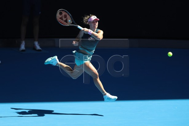Angelique Kerber of Germany in action against Polona Hercog of Slovenia during their women's singles round one match of the Australian Open tennis tournament in Melbourne, Australia, 14 January 2019. EPA-EFE/DAVID CROSLING AUSTRALIA AND NEW ZEALAND OUT